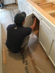 #Mamais workforce installing #kitchen #cabinets. What's your next #project? Call us today! http://bit.ly/1gcjWeK