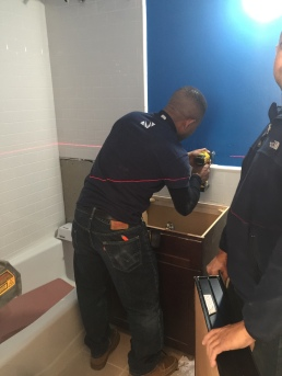 #Mamais workforce installing #bathroom #accessories. What's your next #project? Call us today! http://bit.ly/1gcjWeK