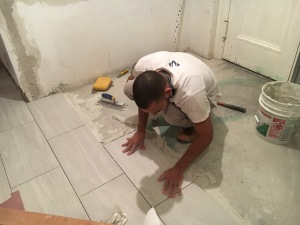 #Mamais workforce installing #ceramic #tiles. What's your next #project? Call us today! http://bit.ly/1gcjWeK