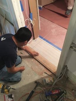 #Mamais workforce installing #oak #door #saddle. What's your next #project? Call us today! bit.ly/1gcjWeK