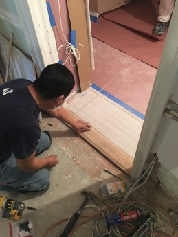 #Mamais workforce installing #oak #door #saddle. What's your next #project? Call us today! bit.ly/1gcjWeK