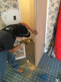 #Mamais workforce installing #door #lock. What's your next #project? Call us today! bit.ly/1gcjWeK